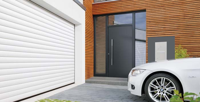 Pose de porte de garage motoris e dr me ard che - Porte de garage sectionnelle motorisee hormann ...