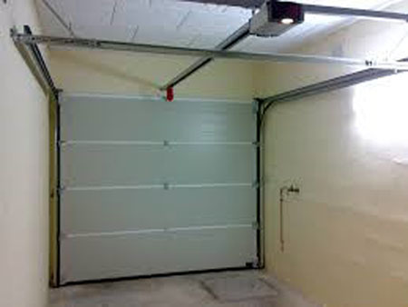 Pose de porte de garage motoris e dr me ard che for Porte de garage sectionnelle harmonic avec portillon